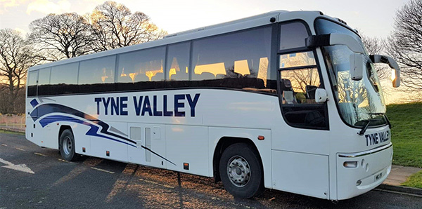 Luxury Coach Tours from Hexham with Tyne Valley Coaches - Exterior of Volvo B12M Plaxton Panther coach with 53 leather seats air conditioning and a toilet